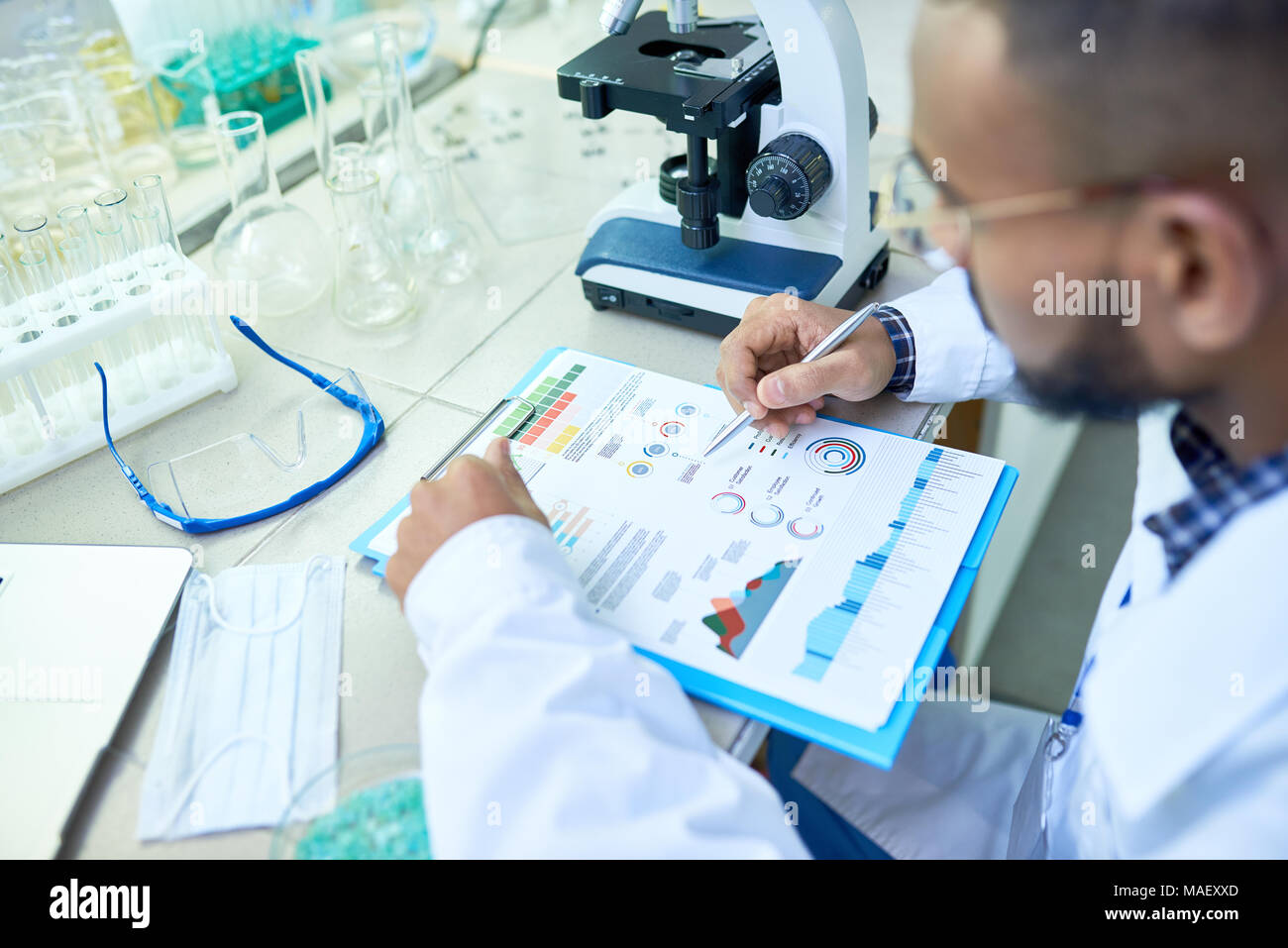 Arabian scientist analyzing research results - Stock Image