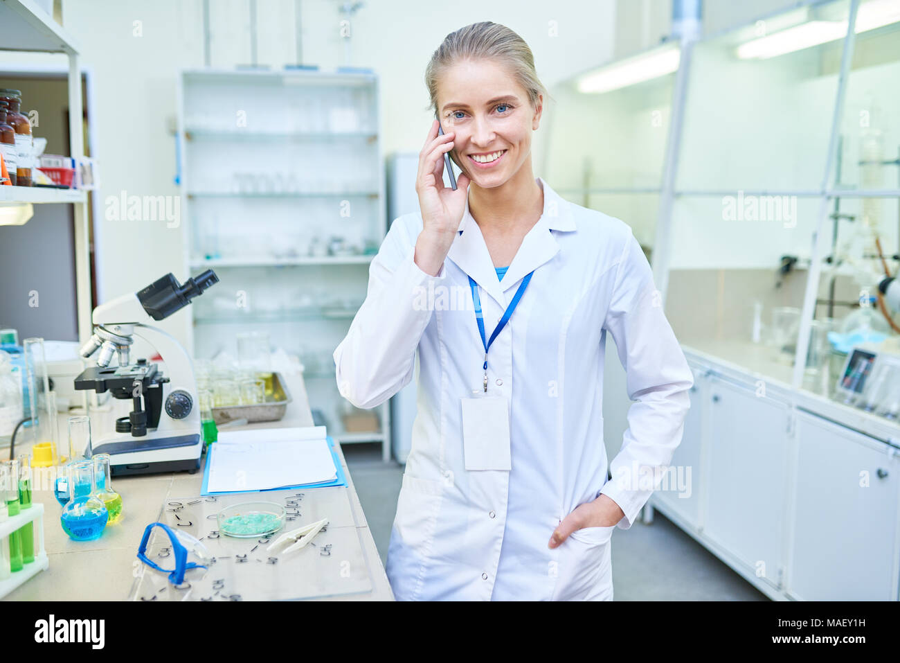 Happy medical specialist in laboratory - Stock Image
