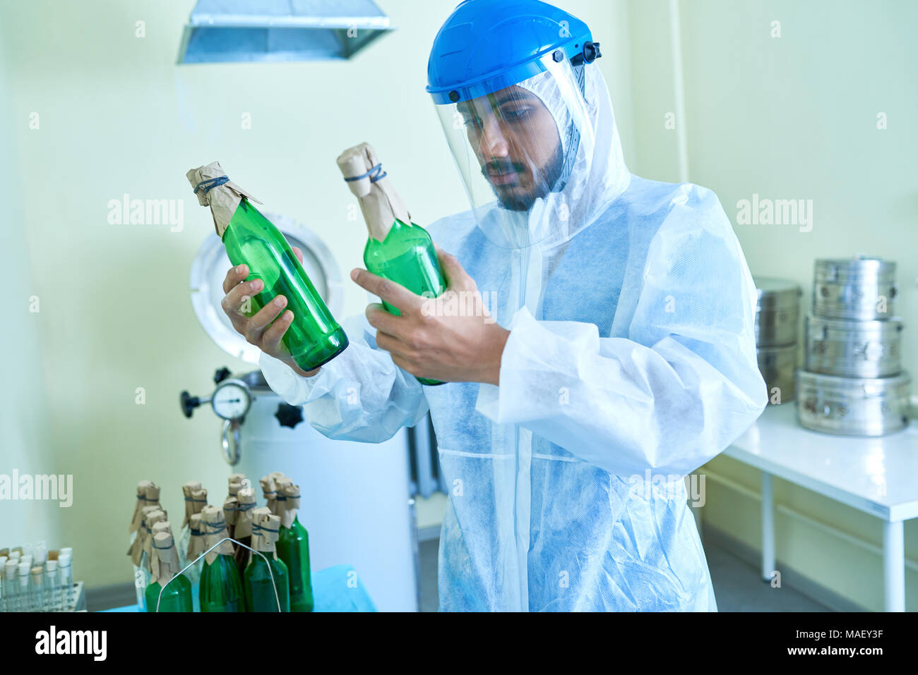 Technician working in chemical plant Stock Photo