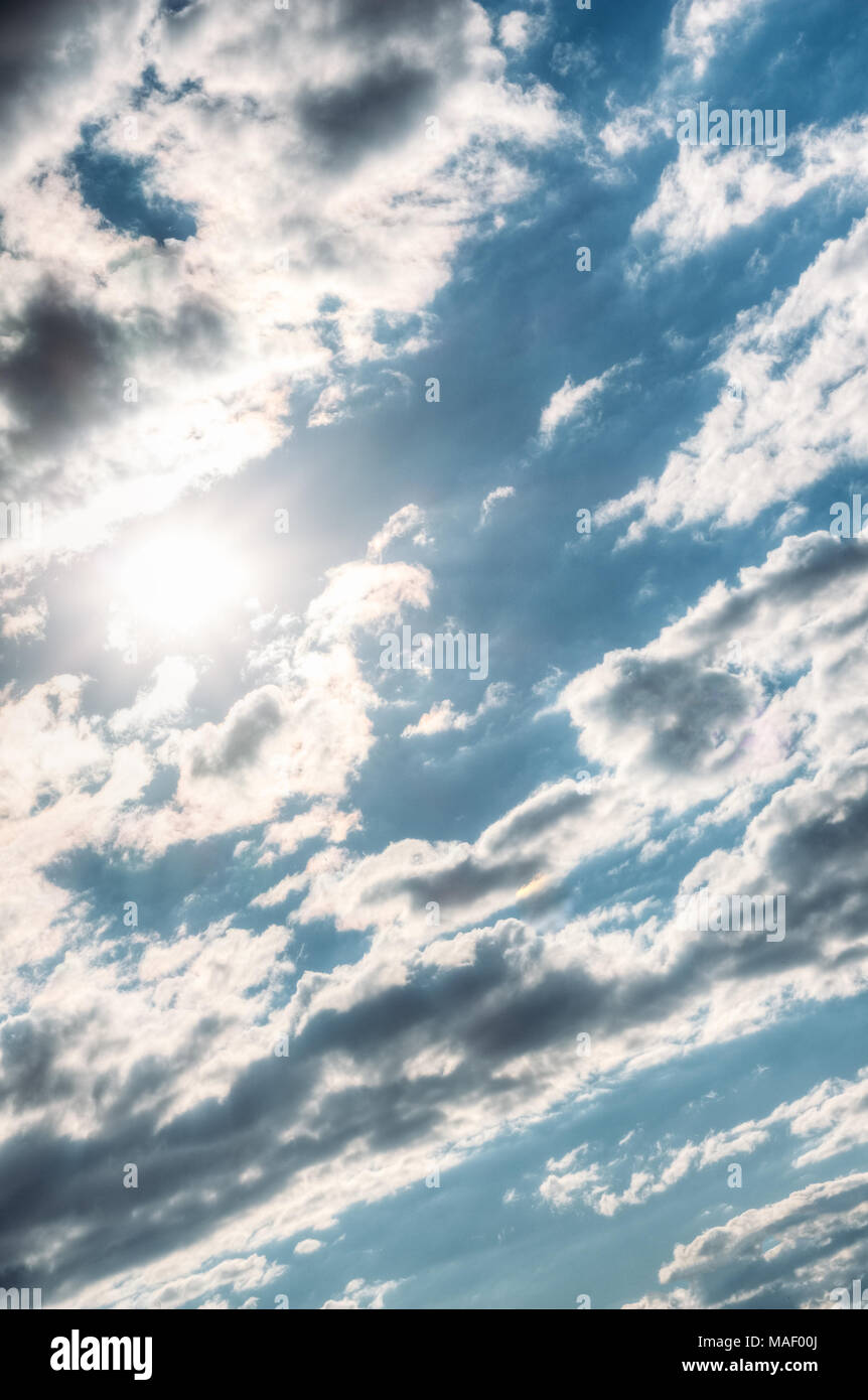The sun in the blue sky with clouds. Summer - Stock Image
