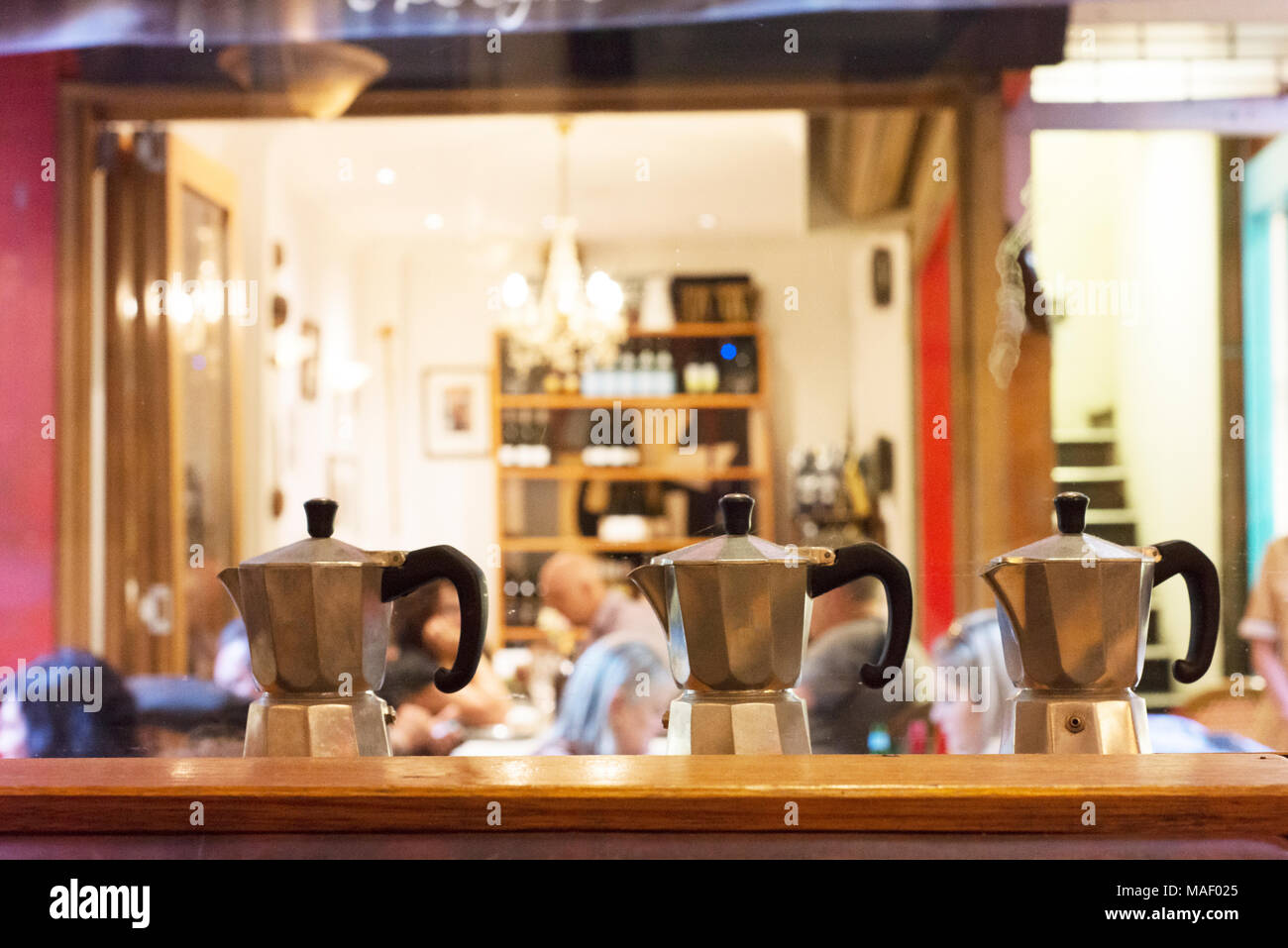 Coffee pots and café patrons in one of Melbourne's laneway cafes. - Stock Image