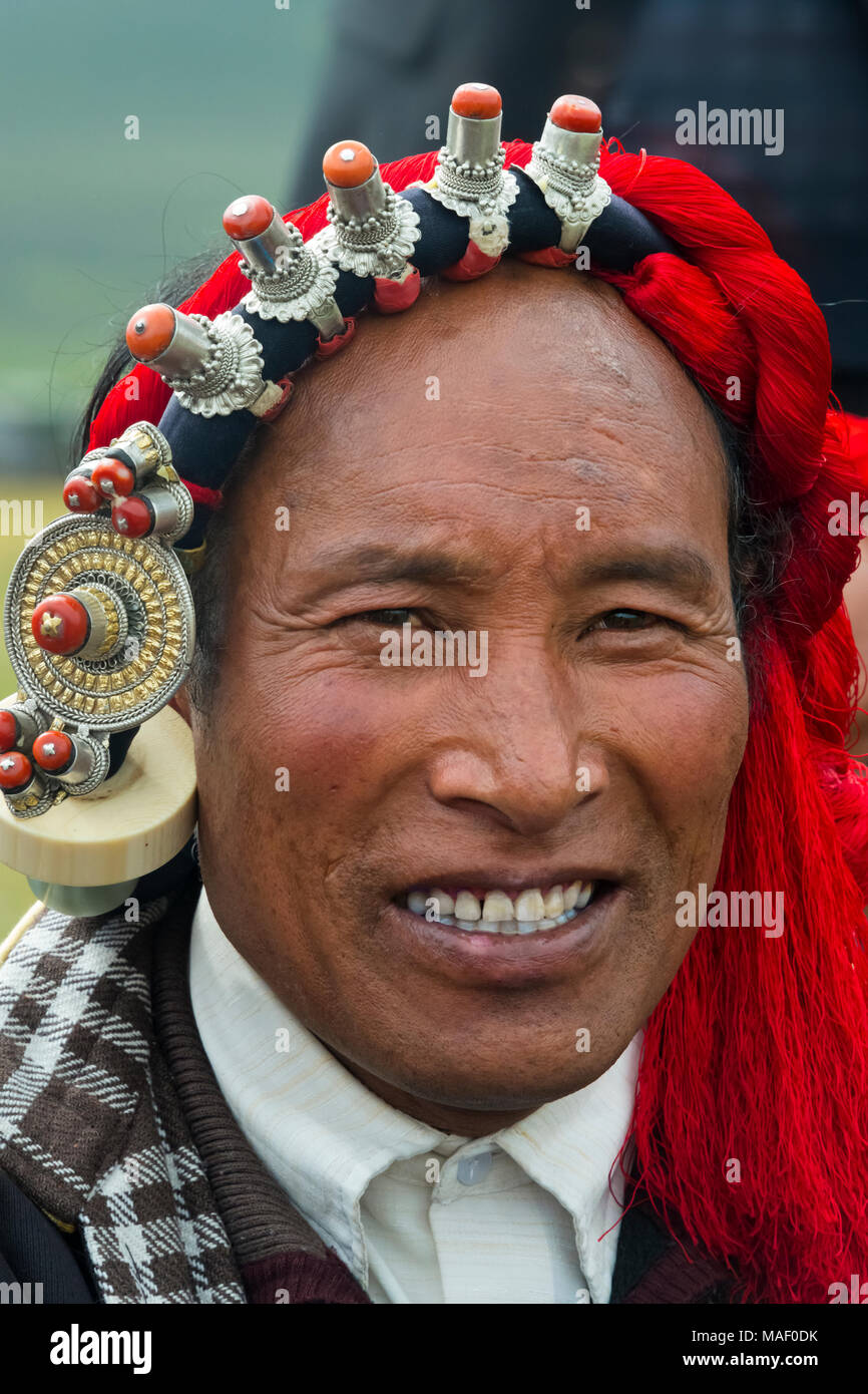 Tibetan man in traditional clothing at Horse Race Festival, Litang, western Sichuan, China - Stock Image