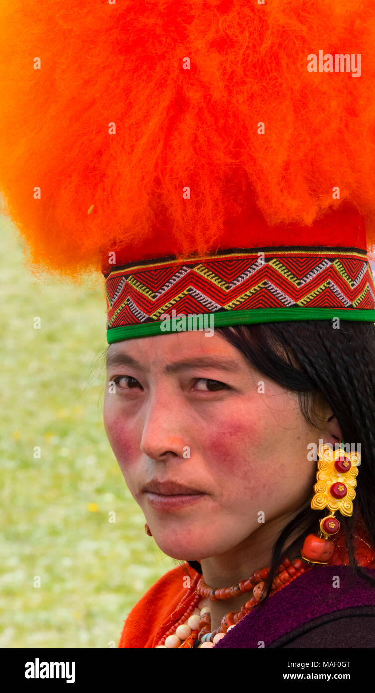 Tibetan girl in traditional clothing at Horse Race Festival, Litang, western Sichuan, China - Stock Image