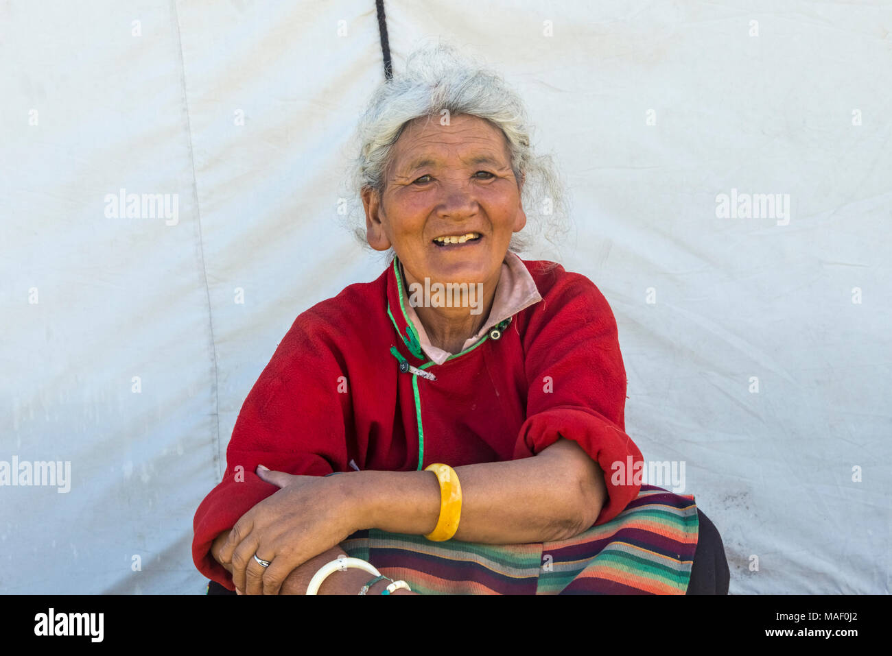 Tibetan woman in traditional clothing at Horse Race Festival, Litang, western Sichuan, China - Stock Image