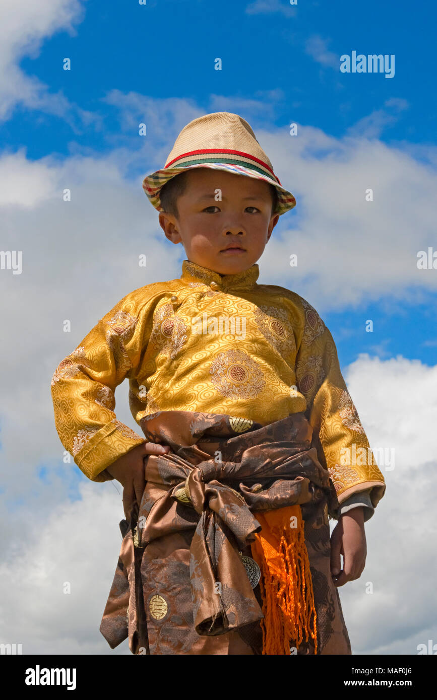 Tibetan boy in traditional clothing at Horse Race Festival, Litang, western Sichuan, China - Stock Image
