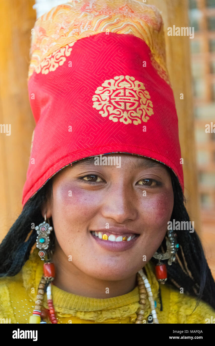 Tibetan woman in traditional clothing, Litang, western Sichuan, China - Stock Image