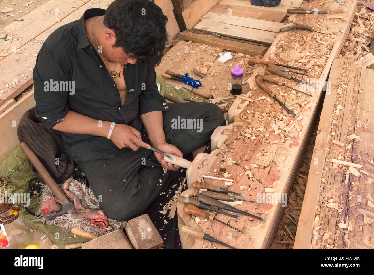 Renovating project at Litang Monastery (Changchunkeersi), carpenter doing wood carving, Litang, western Sichuan, China - Stock Image