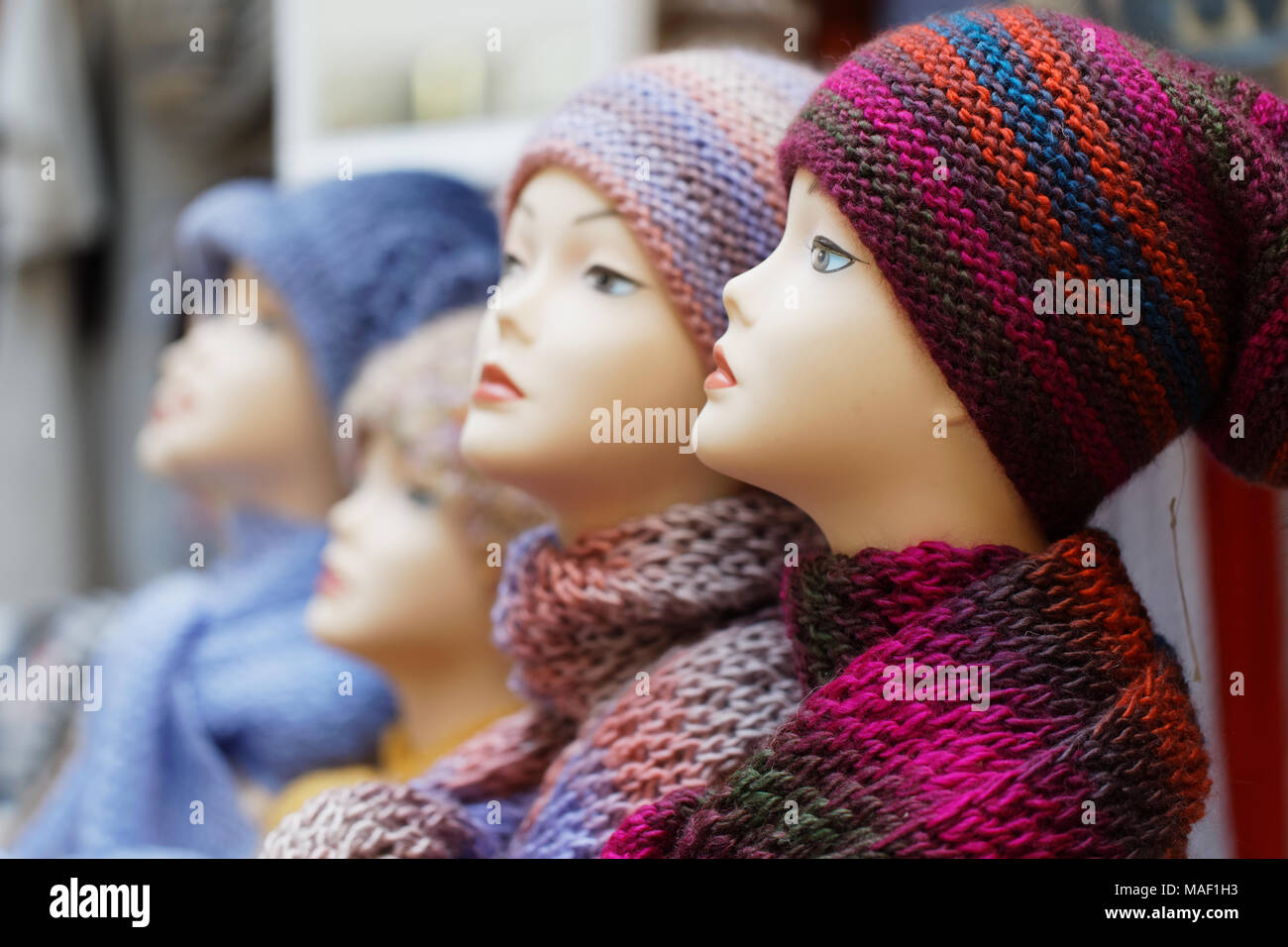 Saint-Petersburg, Russia - March 22, 2018: Knit hats and scarfs on the exhibition Craft Bazaar during TeddyFun 2018. The exhibition is held seasonally - Stock Image