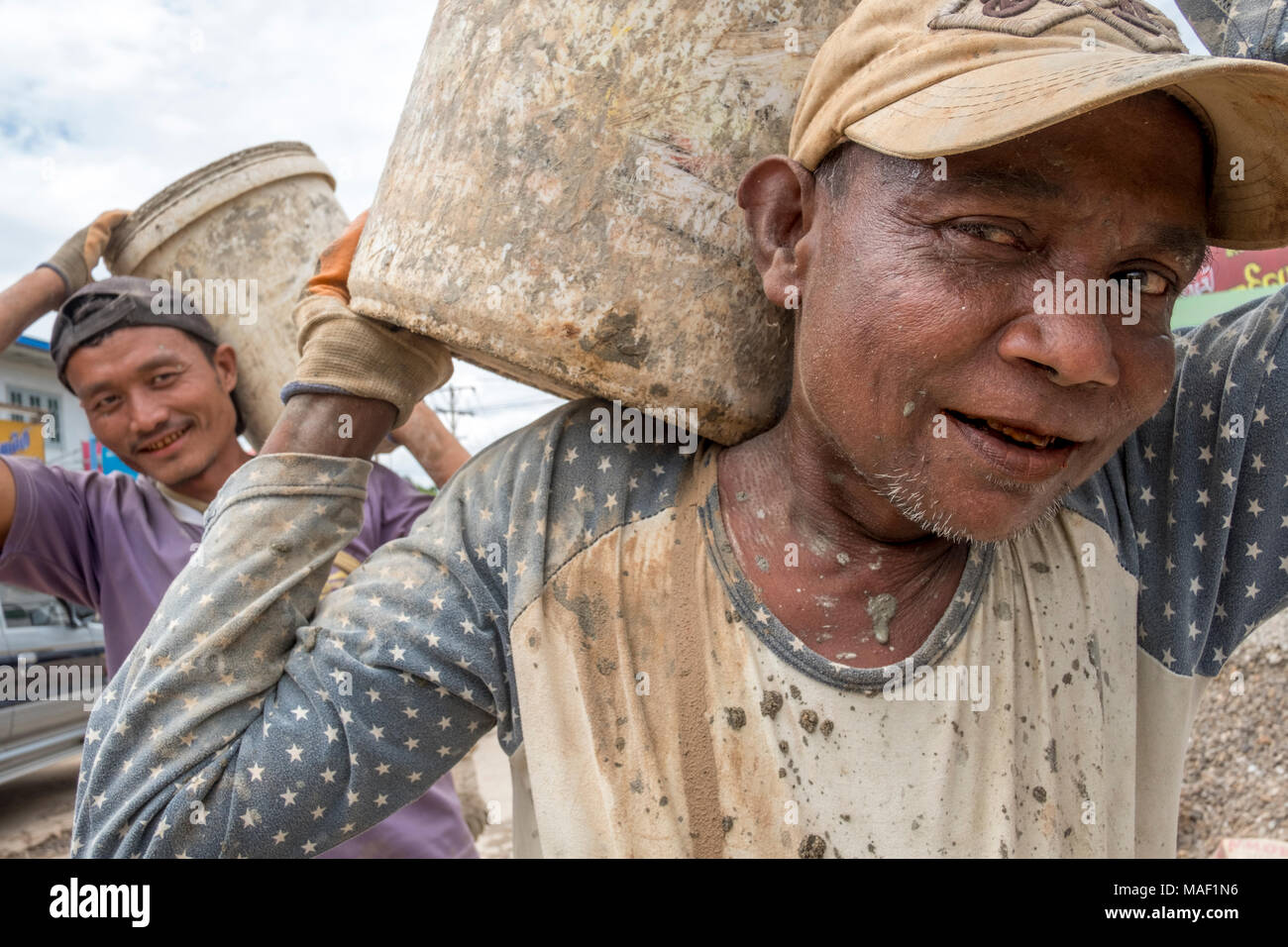 Construction workers on a building site. Lashio, Shan State, Myanmar - Stock Image