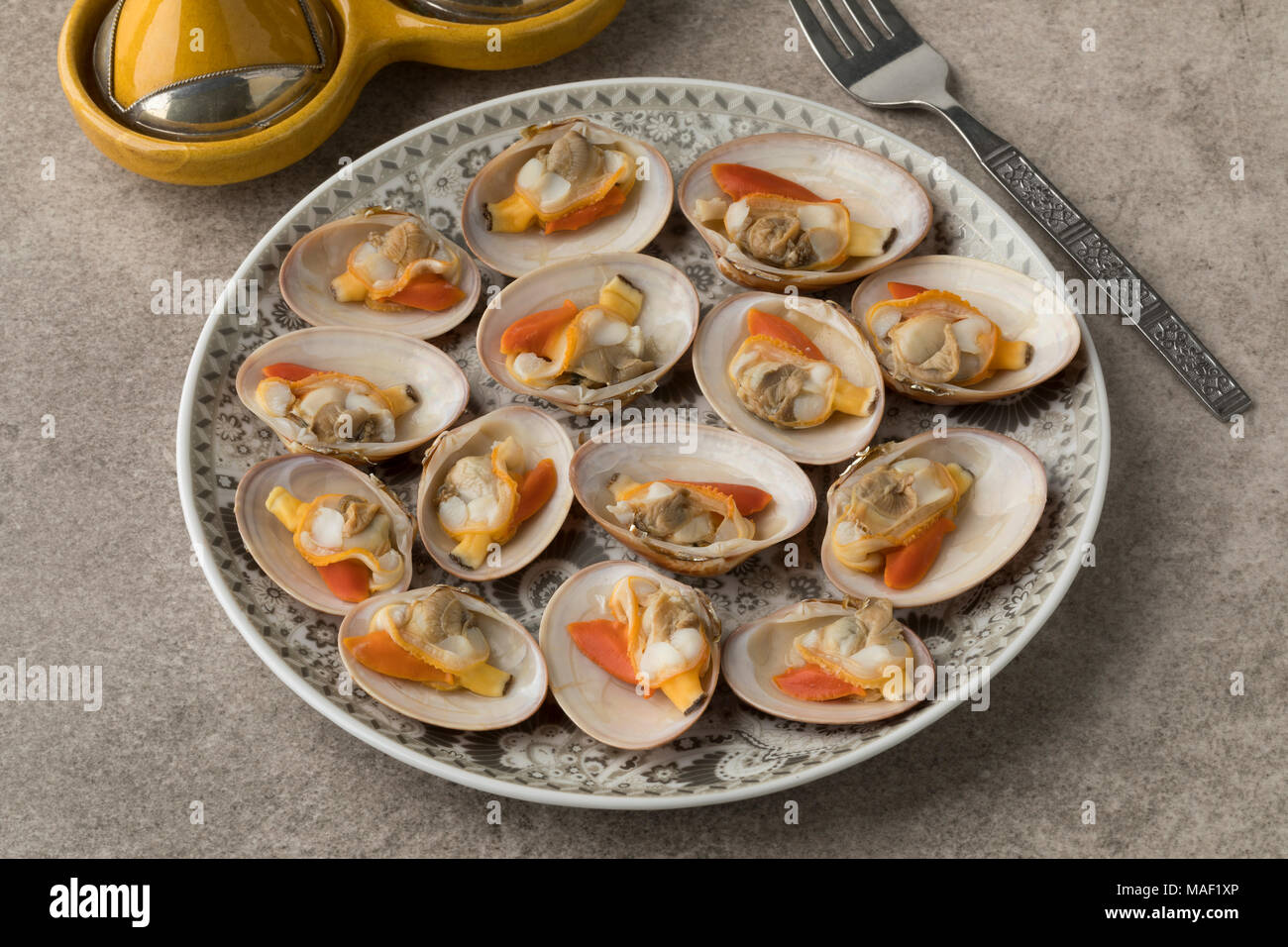 Moroccan dish with open cooked smooth clams for a meal - Stock Image