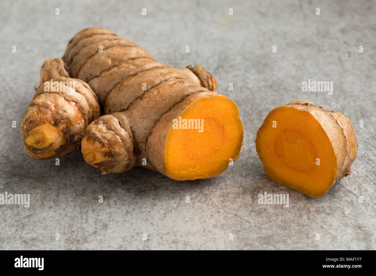 Fresh sliced yellow turmeric rhizome - Stock Image