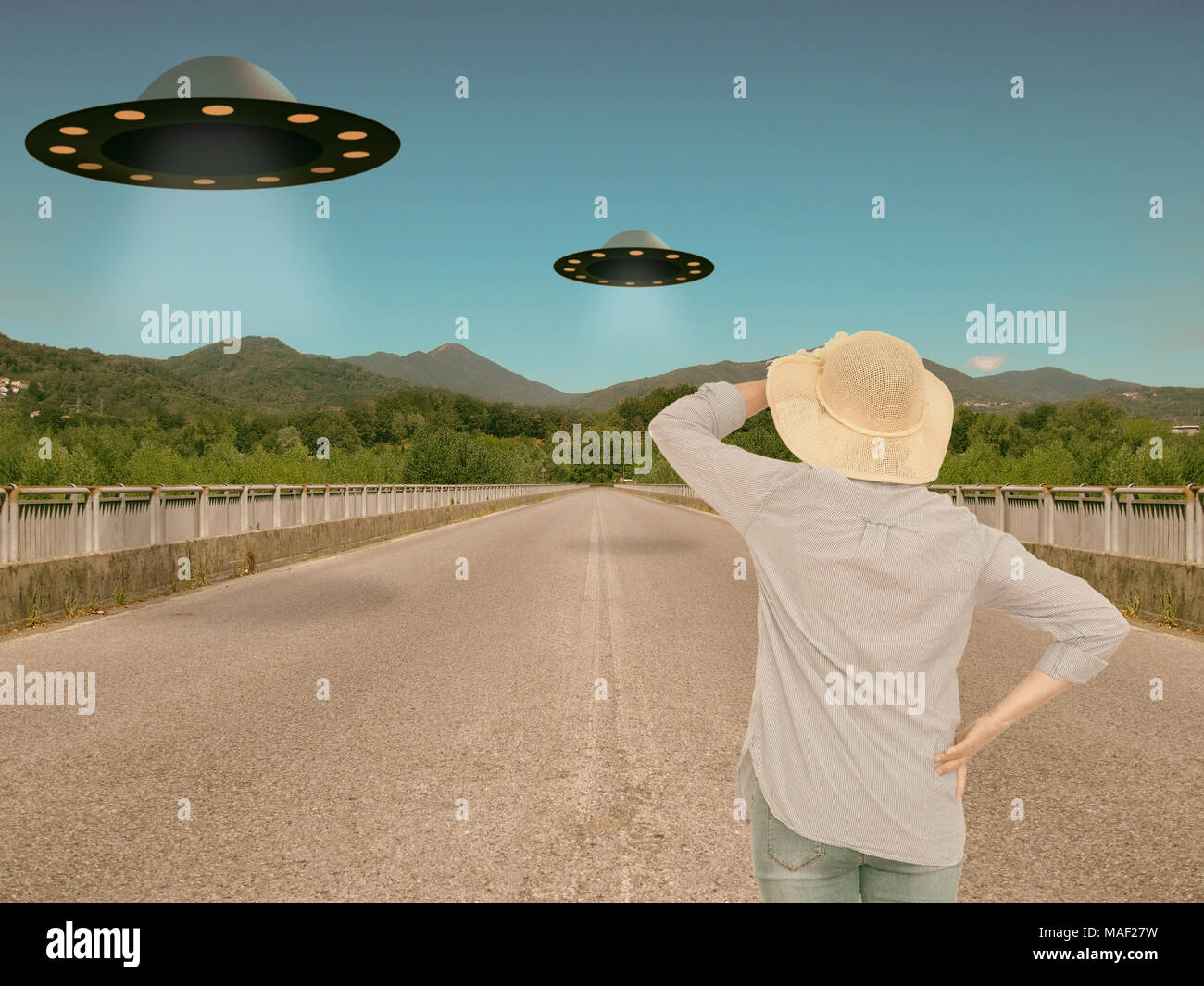 Woman watches UFOs. Vintage styling. - Stock Image