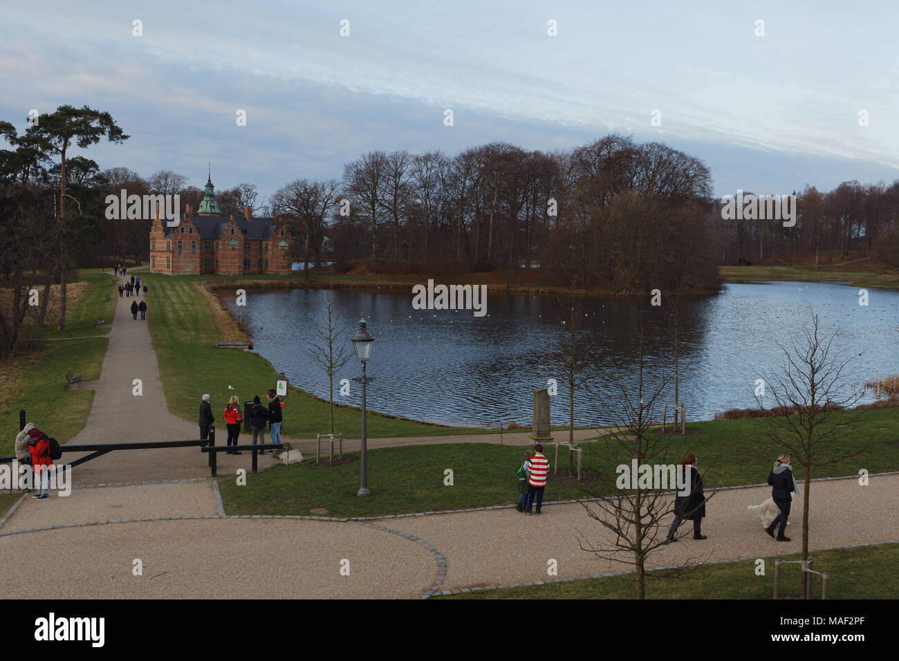 People walking in Frederiksborg Castle Gardens, Hillerod, Denmark - Stock Image