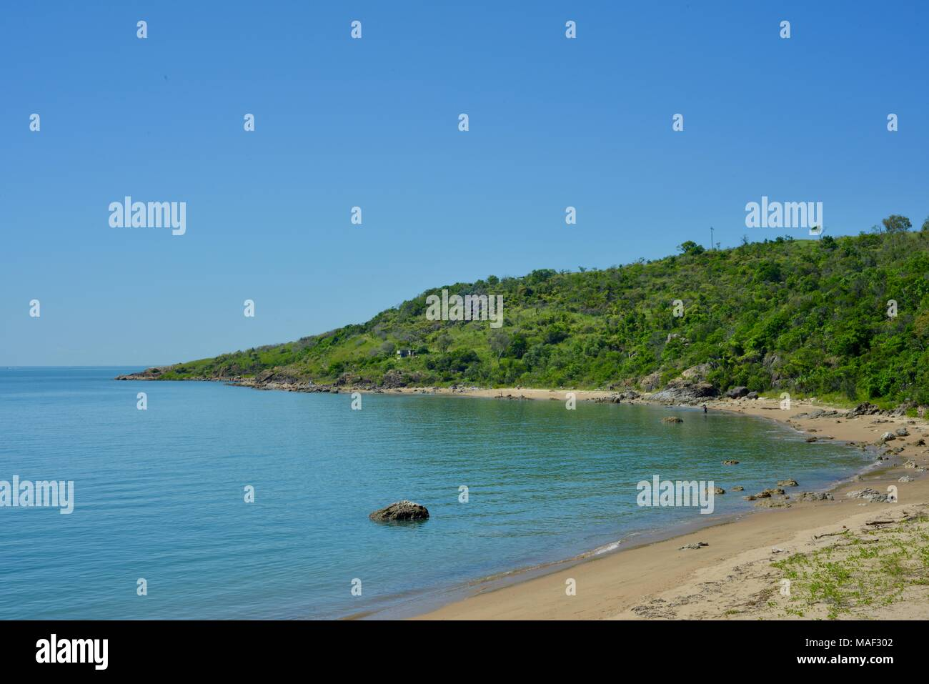 The ocean and beach without people with a feeling of remoteness, Shelly Cove trail at Cape Pallarenda Conservation Park Queensland Australia - Stock Image