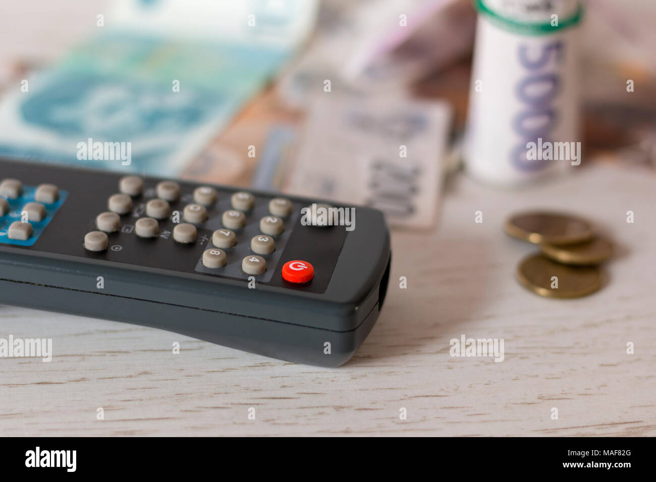 TV remote controle and Serbian paper money, close up shot Stock Photo