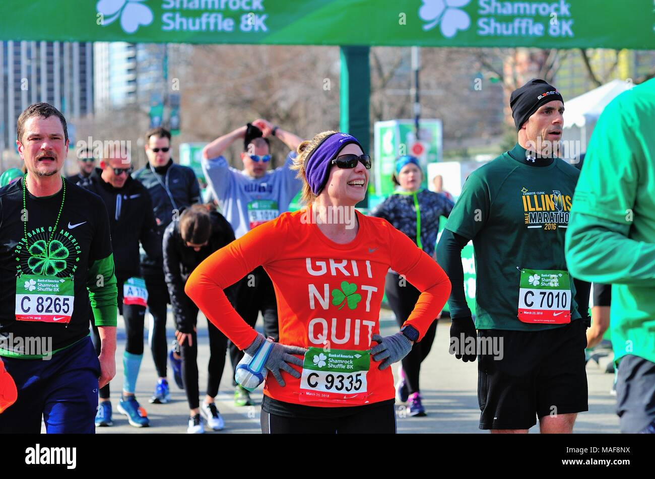 Chicago, Illinois, USA. A happy face among pain and fatigue appears just past the finish line at the 2018 Shamrock Shuffle race in Chicago. - Stock Image
