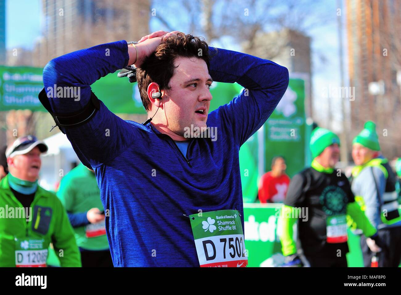 Chicago, Illinois, USA. A tired face of a man just past the finish line at the 2018 Shamrock Shuffle race in Chicago. - Stock Image