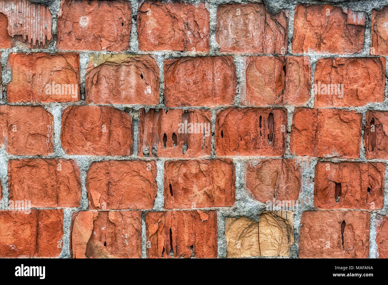 A red brick wall used for the construction of buildings. This photo is abstract and can serve as wallpaper. - Stock Image