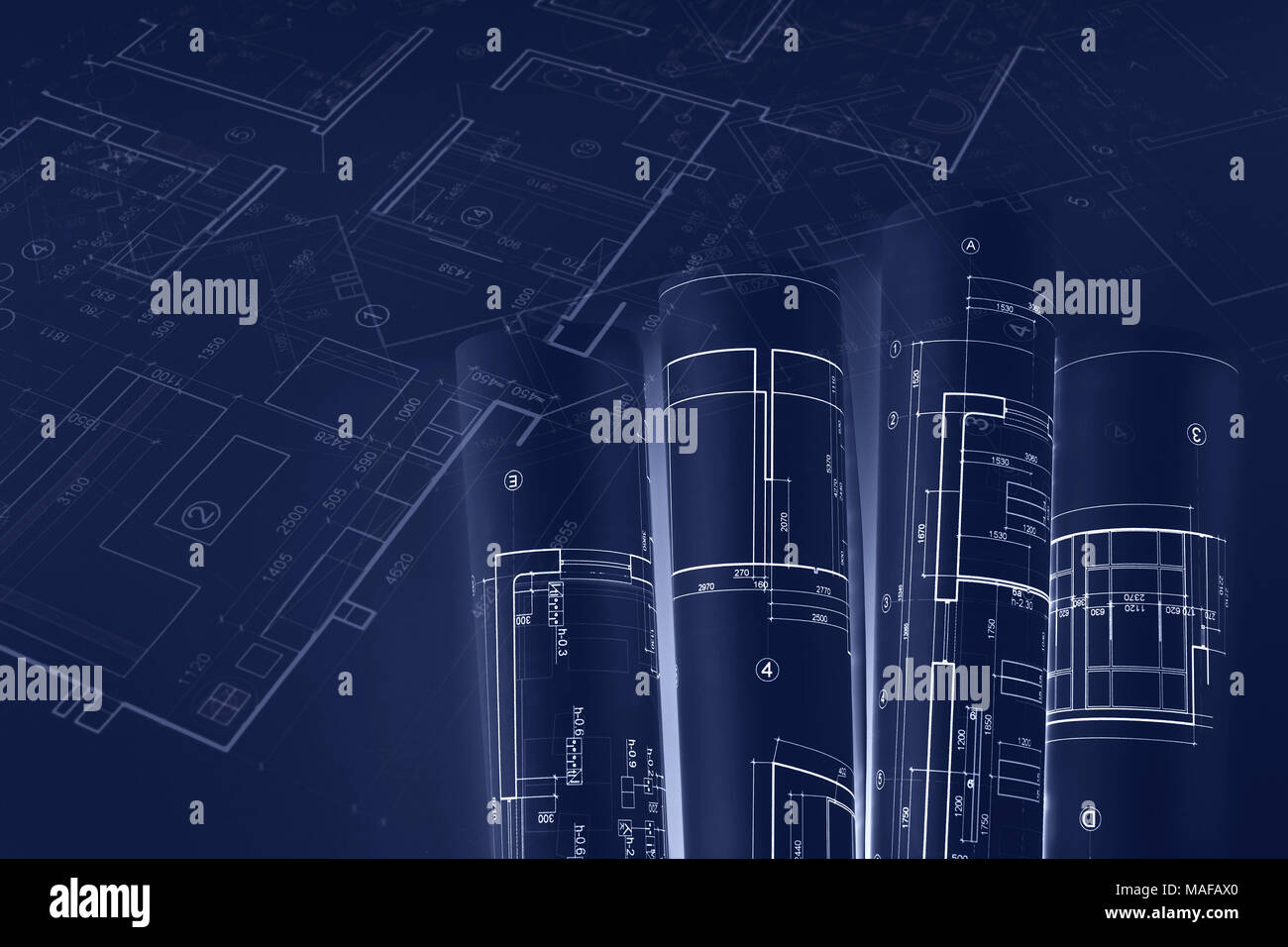 Architectural blueprint rolls technical plan drawings construction architectural blueprint rolls technical plan drawings construction concept blue toned double exposure image malvernweather Gallery