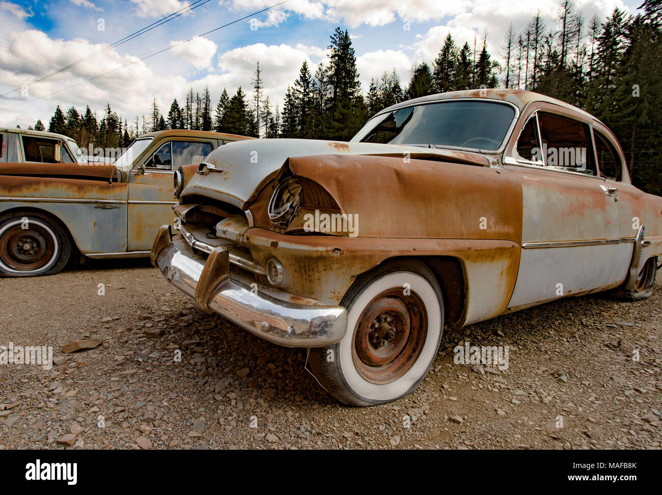 A 1954 Plymouth Savoy two-door Club Coupe, in a stone quarry, east of Clark Fork Idaho. - Stock Image