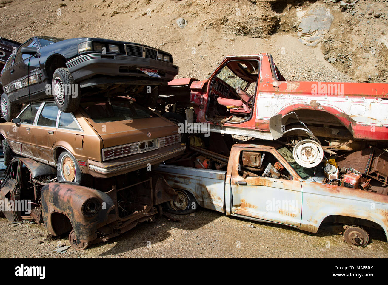 A stack of old junk cars and trucks in an stone quarry, east of ...