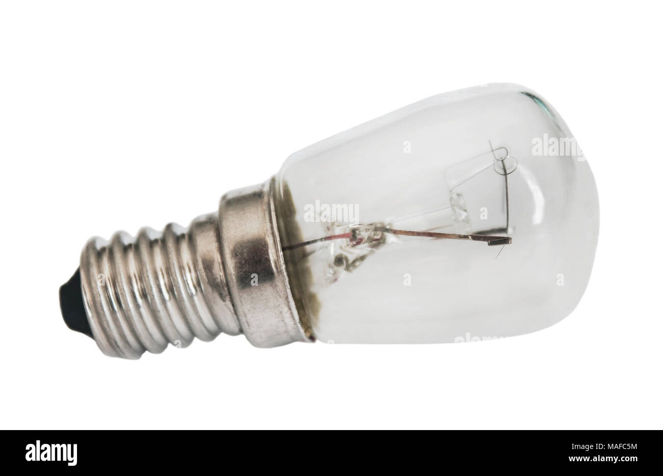 Small electric lamp closeup isolated on white background - Stock Image