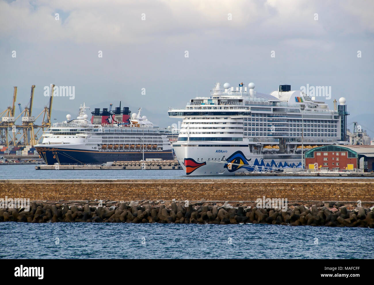 Cruise ship Aida Perla moored in Livorno Harbour Livorno Italy Europe with Disney Magic behind Stock Photo