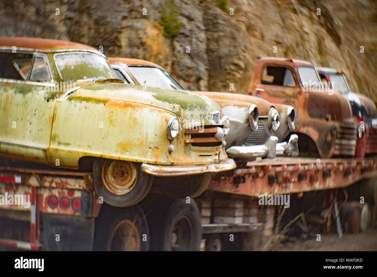 A 1951 Nash Rambler Country Club 2-door hardtop, on a flatbed semi trailer, in a stone quarry, east of Clark Fork, Idaho. - Stock Image