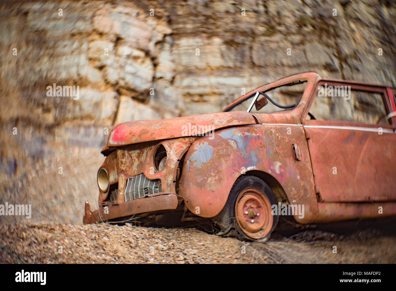 A rusty 1947 Crosley two-door convertible, in a stone quarry, east of Clark Fork Idaho. - Stock Image