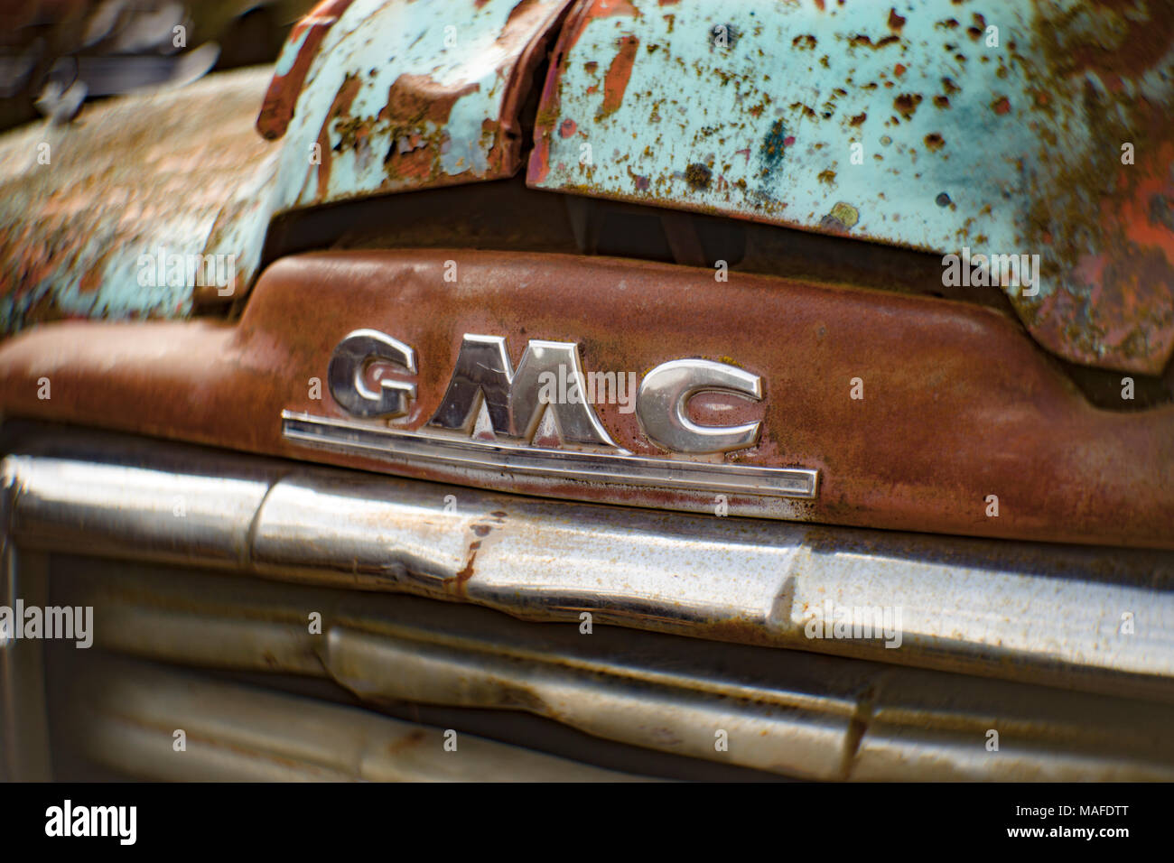 Detail of the chrome GMC logo, on the front of a 1949 GMC truck, in an old stone quarry, east of Clark Fork Idaho. - Stock Image
