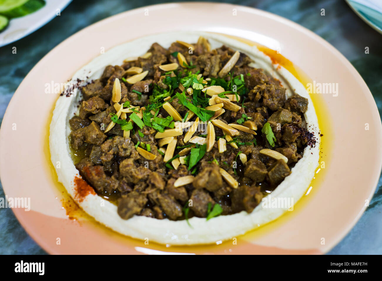 Meat with hummus on a plate traditional arabic food stock photo meat with hummus on a plate traditional arabic food forumfinder Gallery