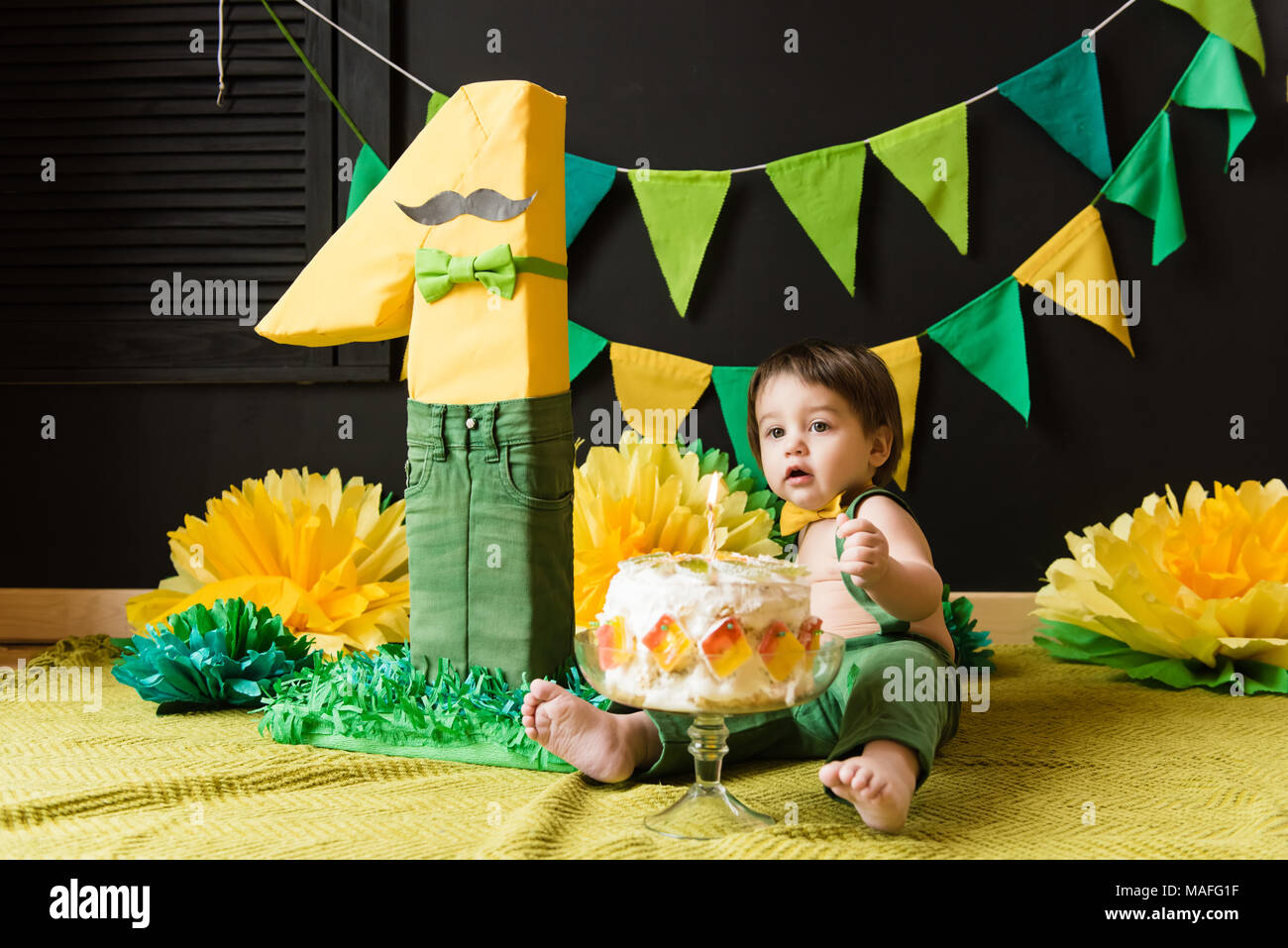 Party Of One Year Old Baby With Yellow And Green Paper Decoration Birthday Boy Figure Cake Candle