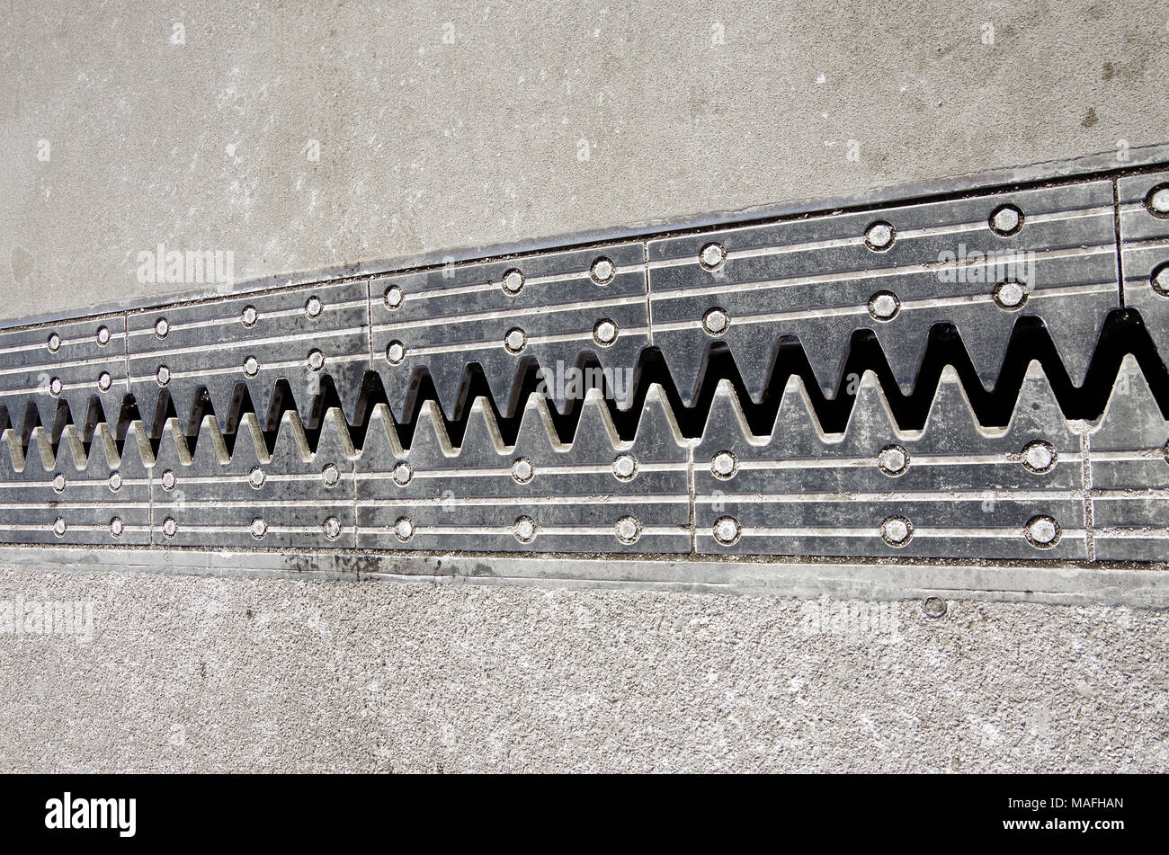 Expansion joint in road bridge open to near it's widest during extremely cold weather, minus 8 degrees C. - Stock Image
