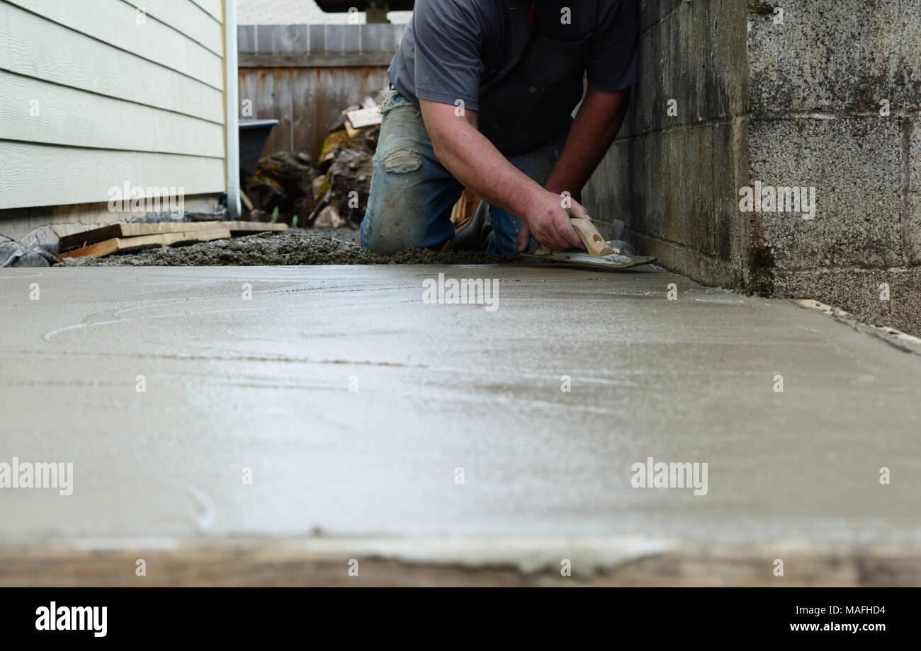 Troweling is tedious Stock Photo