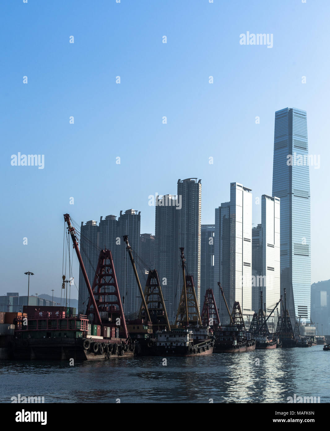 Hong Kong business center with a clear blue sky - Stock Image