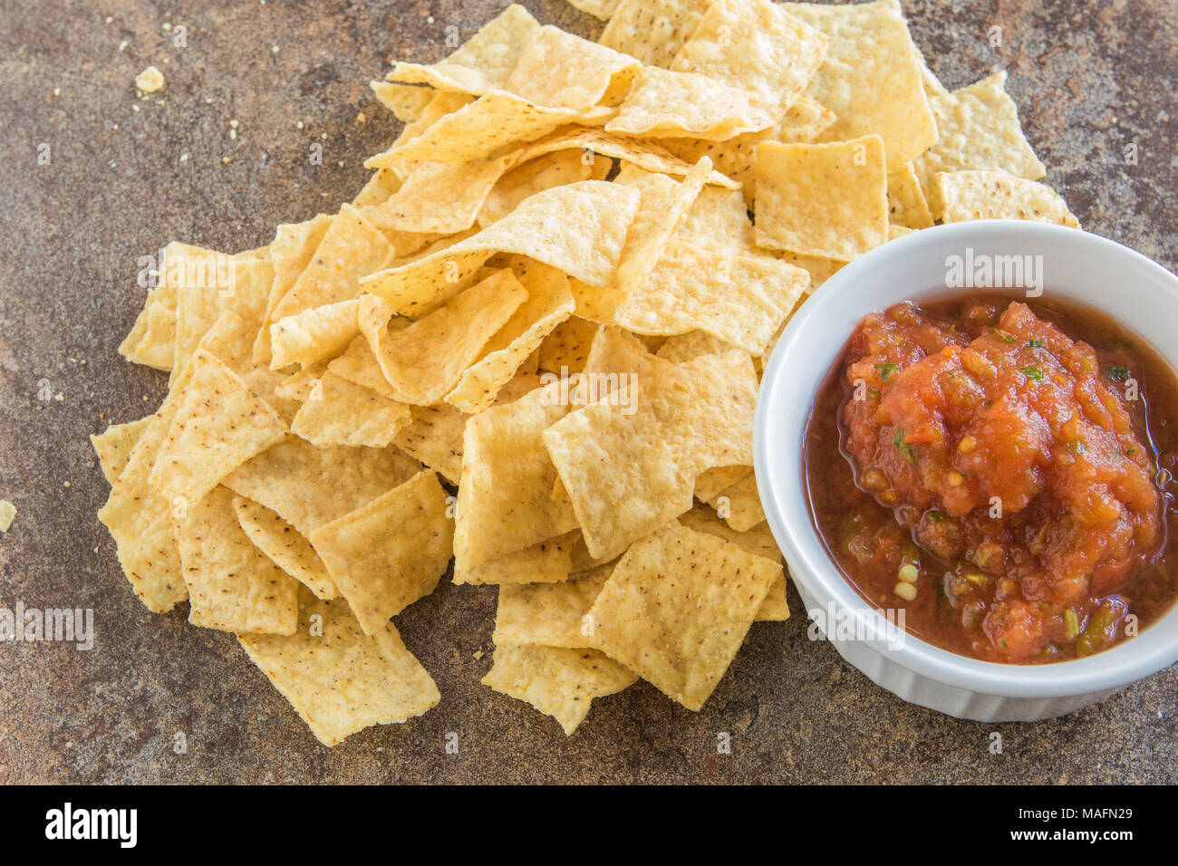 Food. fire roasted tomato salsa with tortilla chips from overhead - Stock Image