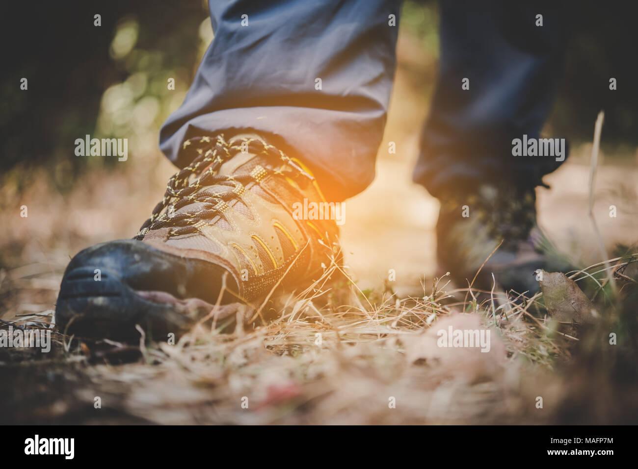 Close Up Of Adventure Man Feet Walk On A Mountain Path Stock