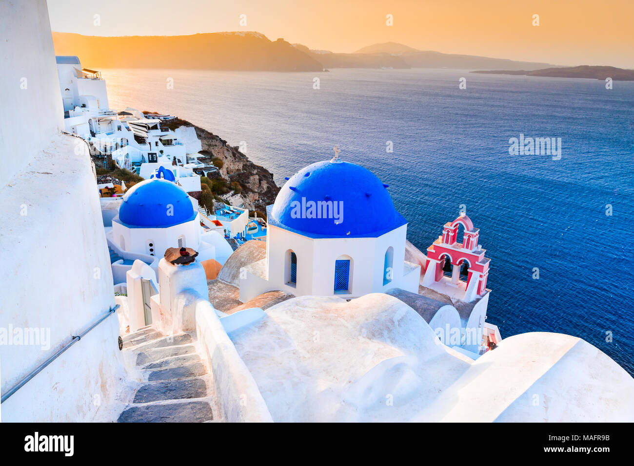 Santorini, Greece. Oia, white village with cobbled narrow paths, famous attraction of Greek Cyclades Islands, Aegean Sea. Stock Photo