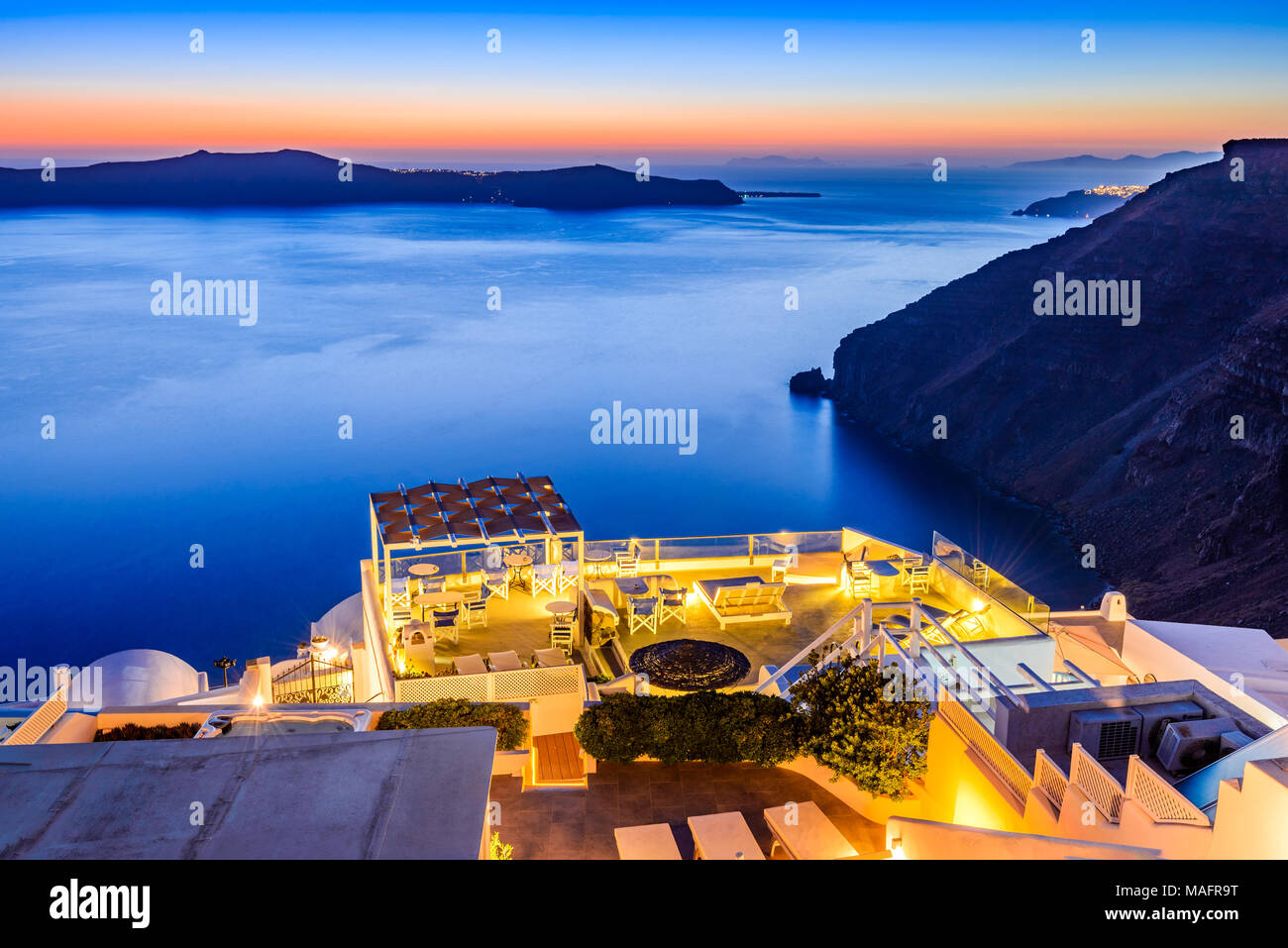 Santorini, Greece. Firostefani twilight, old village in Thira island, Cyclades and Mediterranean Sea. - Stock Image