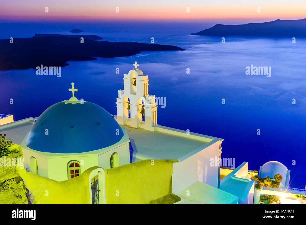 Santorini, Greece. Firostefani twilight with old greek church and caldera at Aegean Sea. - Stock Image