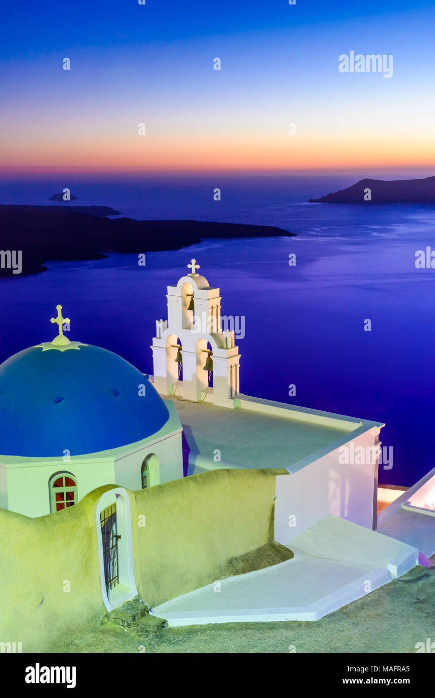 Santorini, Greece. Firostefani twilight with old greek church and caldera at Aegean Sea. - Stock Image