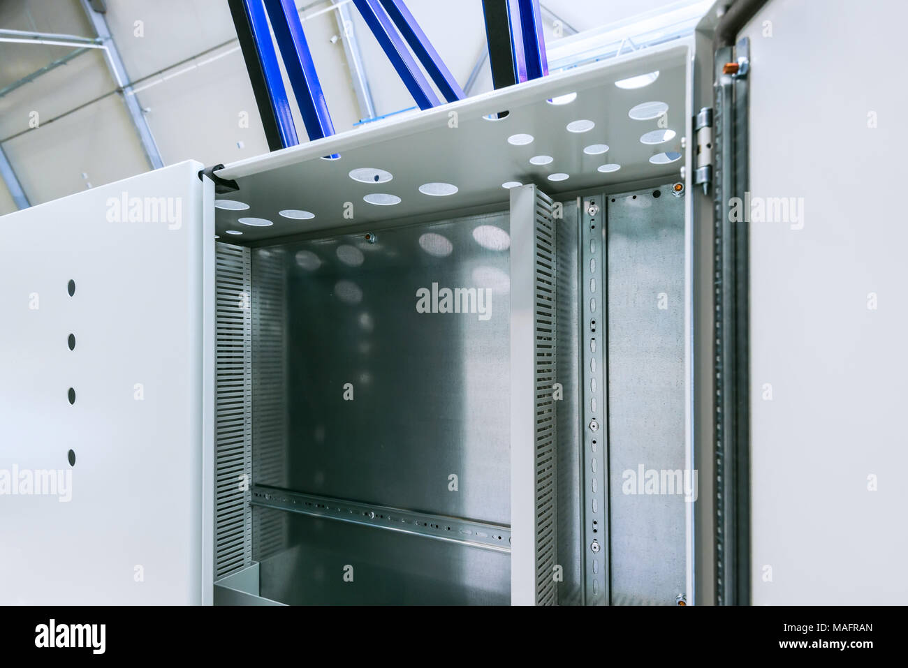 Industrial enclosure cabinet for electrical equipment with lamp and cooling unit. - Stock Image