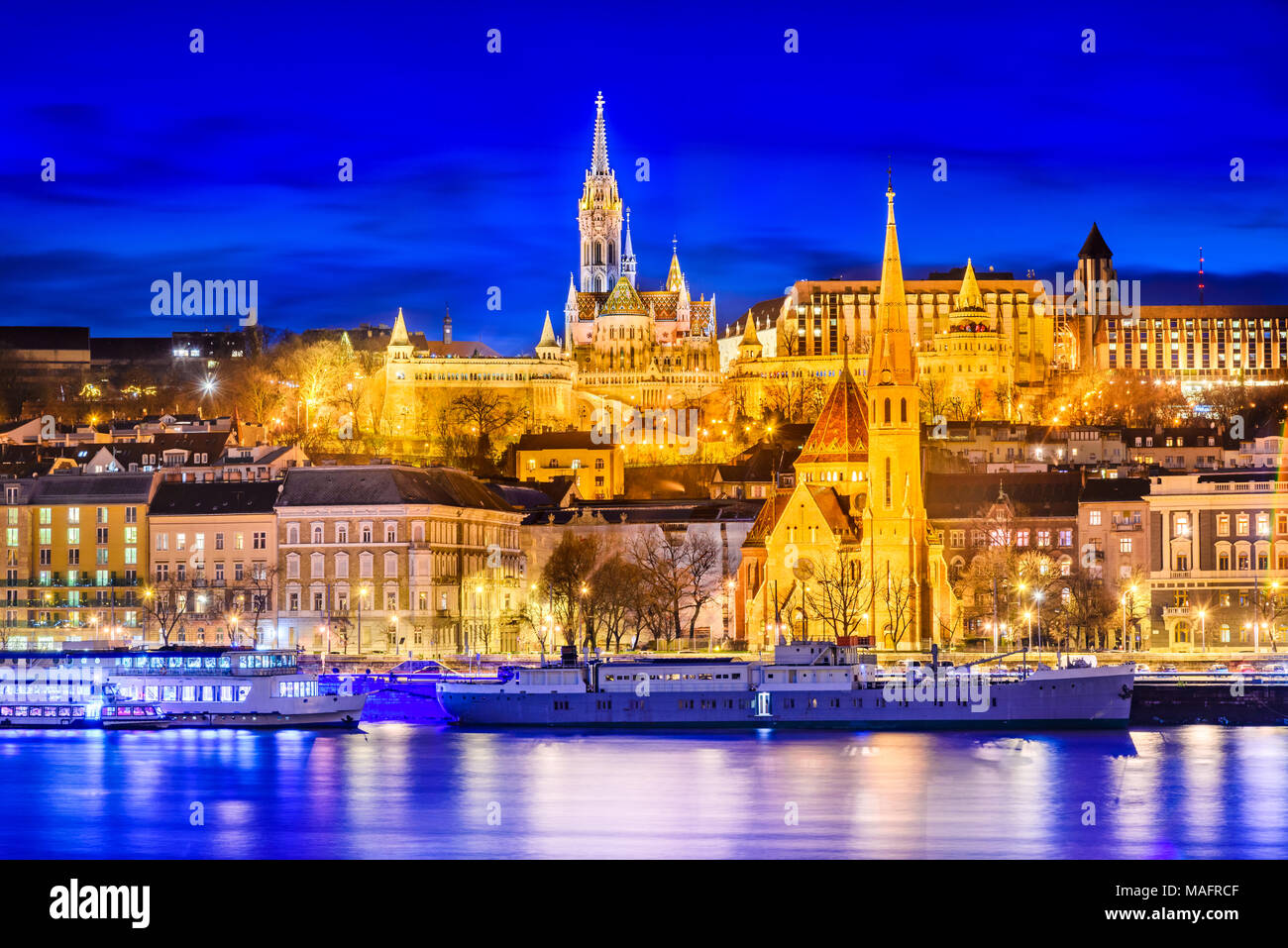 Budapest, Hungary. Matyas Church, Buda Hill and Fishermen Bastion, twilight hour. - Stock Image