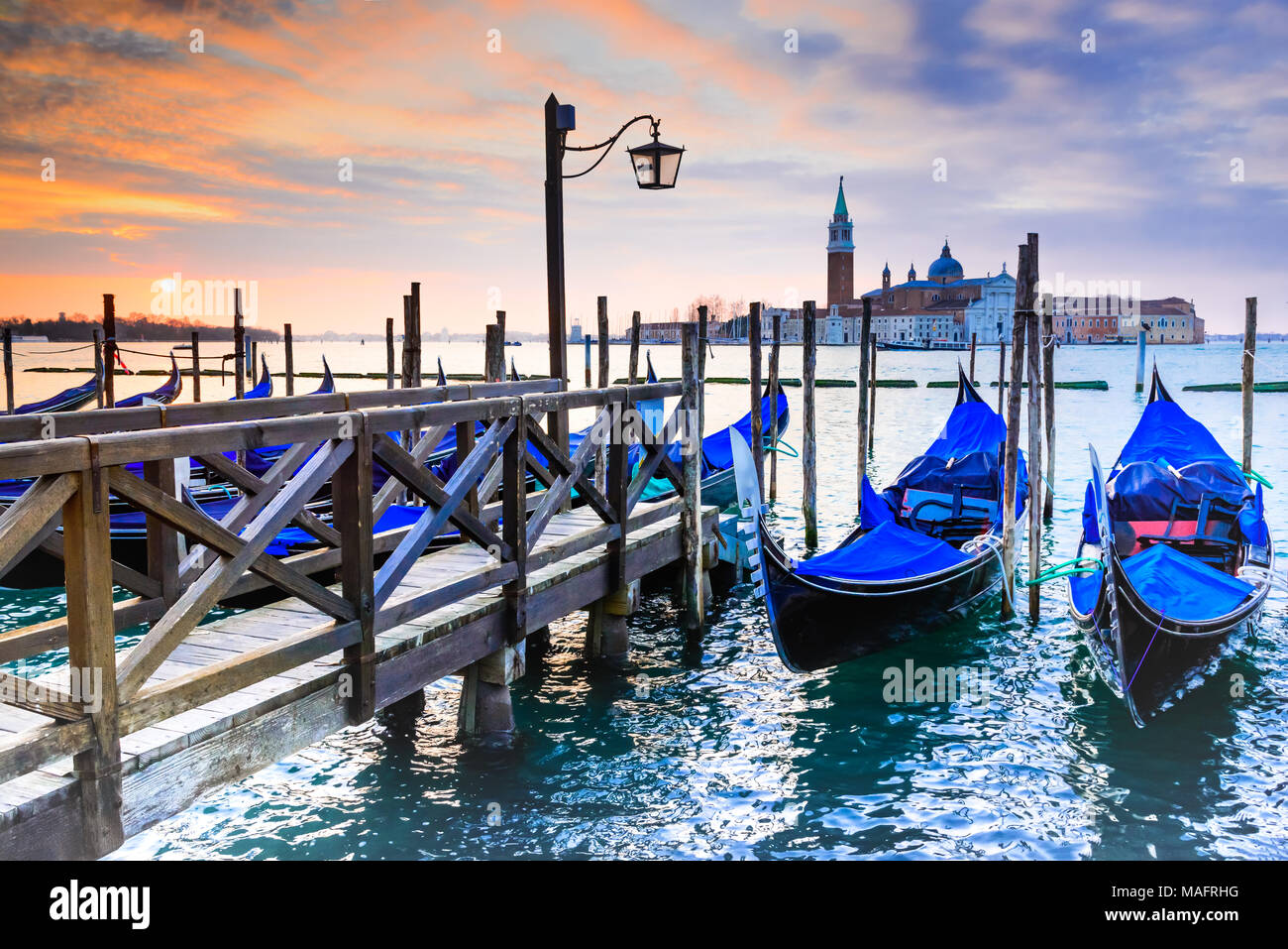 Venice, Italy. Sunrise with Gondolas on Grand Canal, Piazza San Marco, Adriatic Sea. Stock Photo