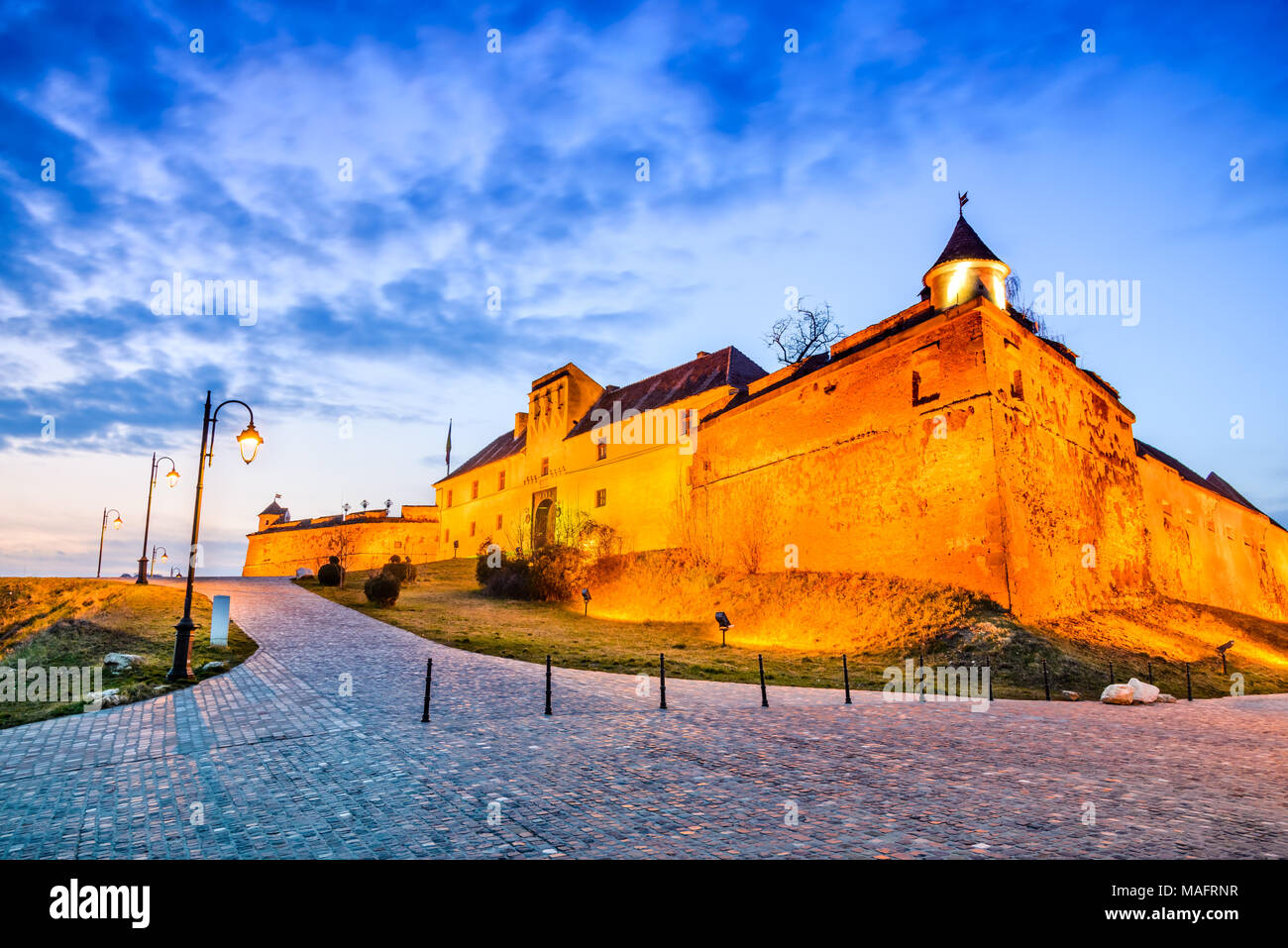 Brasov, Romania - The Citadel. Stunning twilight HDR image with medieval hilltop fortress of Corona medieval city in Transylvania. - Stock Image