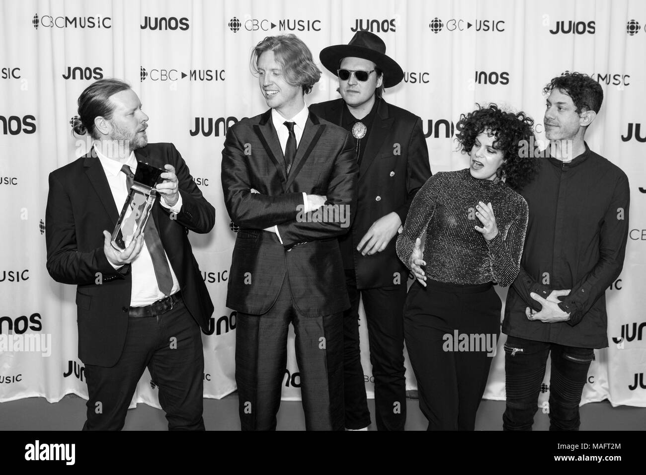 Vancouver, CANADA. 24th March, 2018. Arcade Fire pose with their International Acheievement Award at the 2018 Juno Awards gala in Vancouver. Credit: B - Stock Image