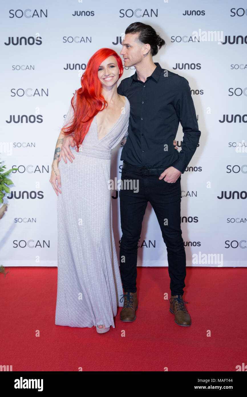 Vancouver, CANADA. 24th March, 2018. Lights and husband Beau Bokan on the red carpet at the 2018 Juno Awards gala in Vancouver. Bobby Singh/fohphoto - Stock Image