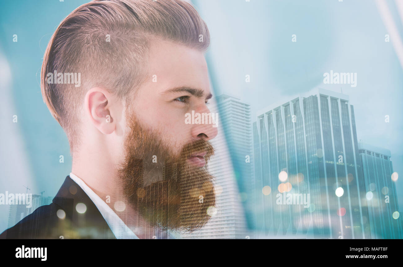 Businessman looks far for the future. Concept of innovation and startup. double exposure - Stock Image