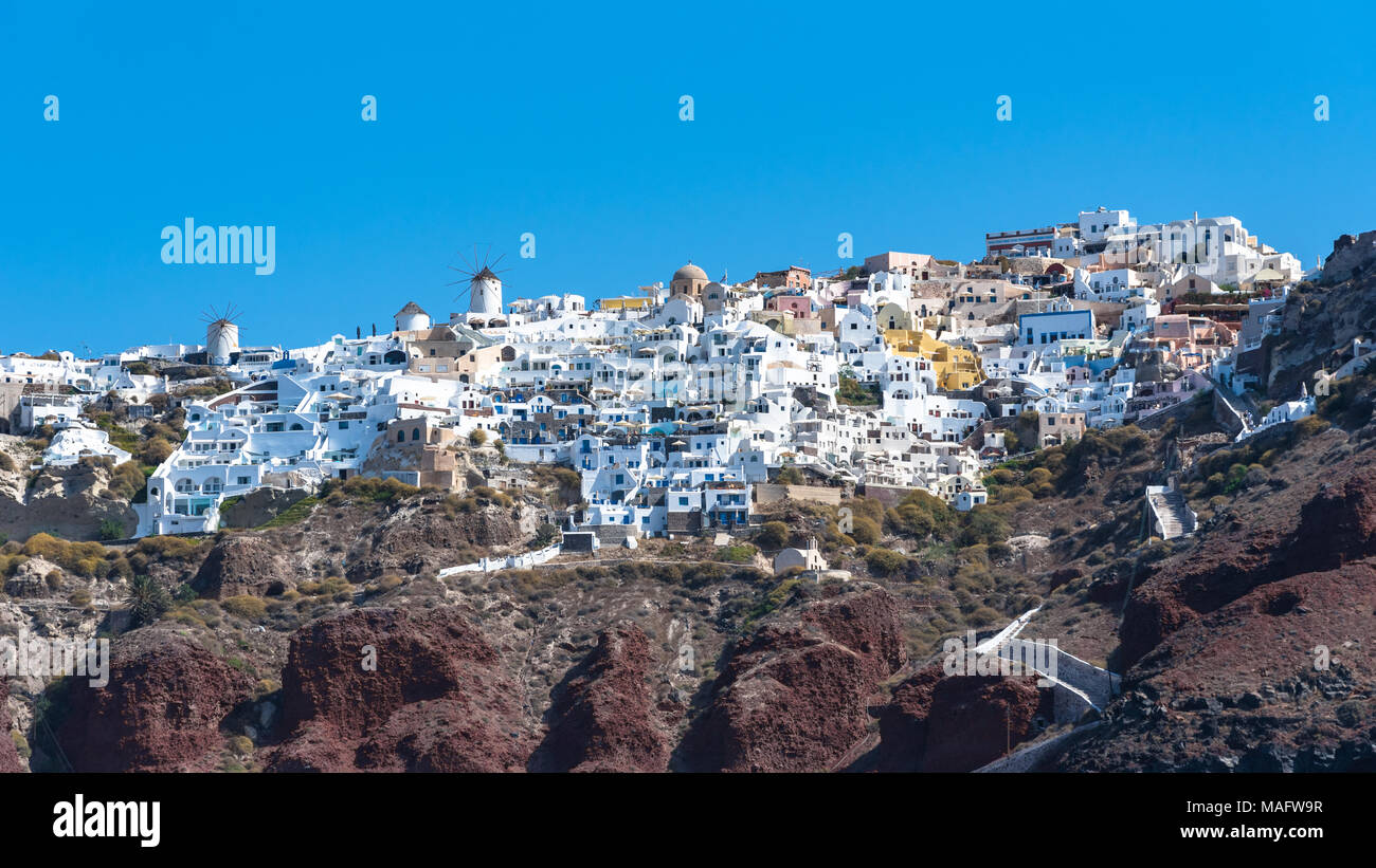 Oia on Santorini as seen from below with a blue sky - Stock Image