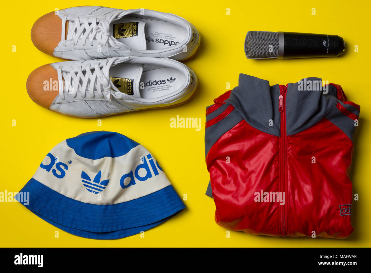 a fantastic studio shot of street wear fashion taken from above against a bright yellow background - Stock Image